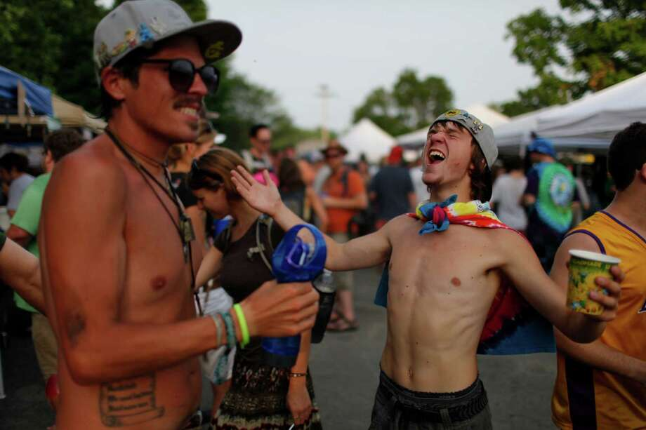 Dylan, right, from Boston, gets cooled off by a spray fan outside of the Saratoga Performing Arts Center prior to the Phish concert, Friday, July 6, 2012 in Saratoga Springs, N.Y. (Dan Little/Special to the Times Union) Photo: Dan Little / Copyright: All Rights Reserved Brett Carlsen