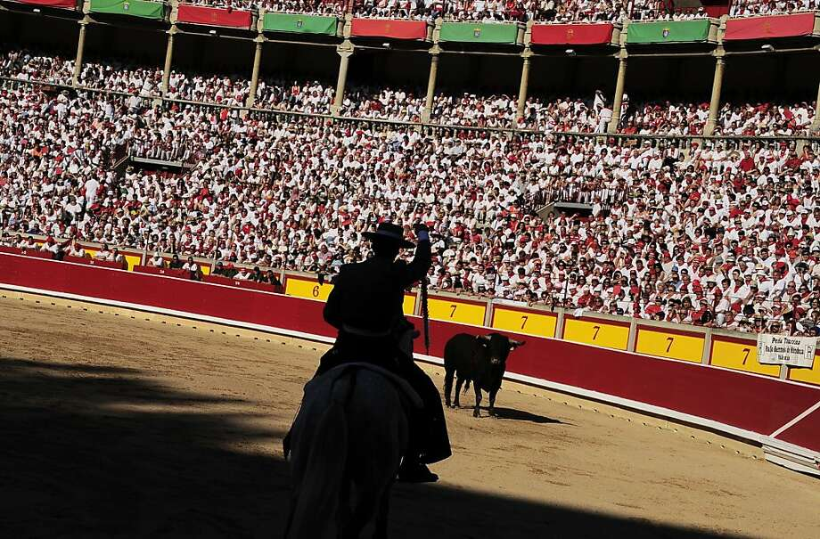 Spanish mounted bullfighter Roberto Armendariz in front of a bull during a horseback bullfight at San Fermin Fiestas, in Pamplona, northern Spain, Friday, July 6, 2012. (AP Photo/Alvaro Barrientos) Photo: Alvaro Barrientos, Associated Press