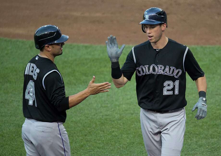 Tyler Colvin, right, homered twice off Nationals star Stephen Strasburg to back a masterful pitching performance by Drew Pomeranz in the Rockies' 5-1 road win. Photo: Harry E. Walker / McClatchy-Tribune Photo Service 2009