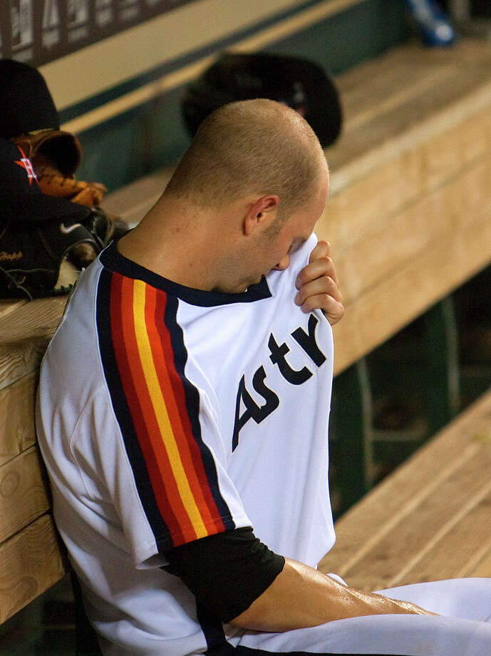 Astros pitcher J.A. Happ is unable to wipe away the two homers he gave up in the first inning or the seven runs he allowed during his 61⁄3-inning stint Friday. Photo: Cody Duty / © 2011 Houston Chronicle