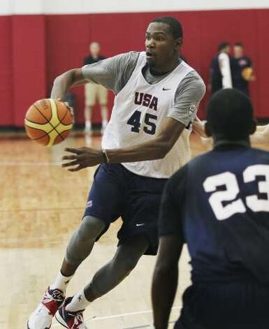 Kevin Durant (45) makes a pass as the U.S. men's national basketball team practices at the Mendenhall Center on the UNLV campus in Las Vegas on Friday, July 6, 2012. (Jason Bean / AP Photo/Las Vegas Review-Journal)