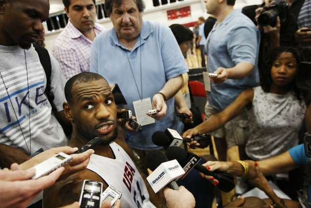 USA men's basketball national team member LeBron James, center, talks with the media after practice at the Mendenhall Center on the UNLV campus in Las Vegas on Friday, July 6, 2012. (Jason Bean / AP Photo/Las Vegas Review-Journal)