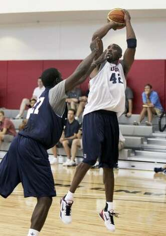 USA men's basketball national team member Kobe Bryant (42) shoots over Jrue Holliday during practice at the Mendenhall Center on the UNLV campus in Las Vegas on Friday, July 6, 2012. (Jason Bean / AP Photo/Las Vegas Review-Journal)