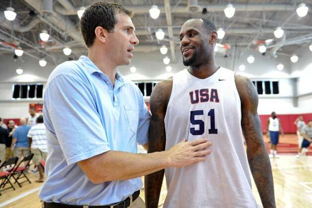 Cleveland Cavaliers General Manager Chris Grant, left, talks with LeBron James after the Team USA men's basketball practice at the Mendenhall Center on the UNLV campus in Las Vegas, Friday, July 6, 2012. Team USA will train in Las Vegas from July 6-12th culminating with a game against the Dominican Republic at the Thomas & Mack Center. (David Cleveland / AP Photo/Las Vegas Review-Journal)