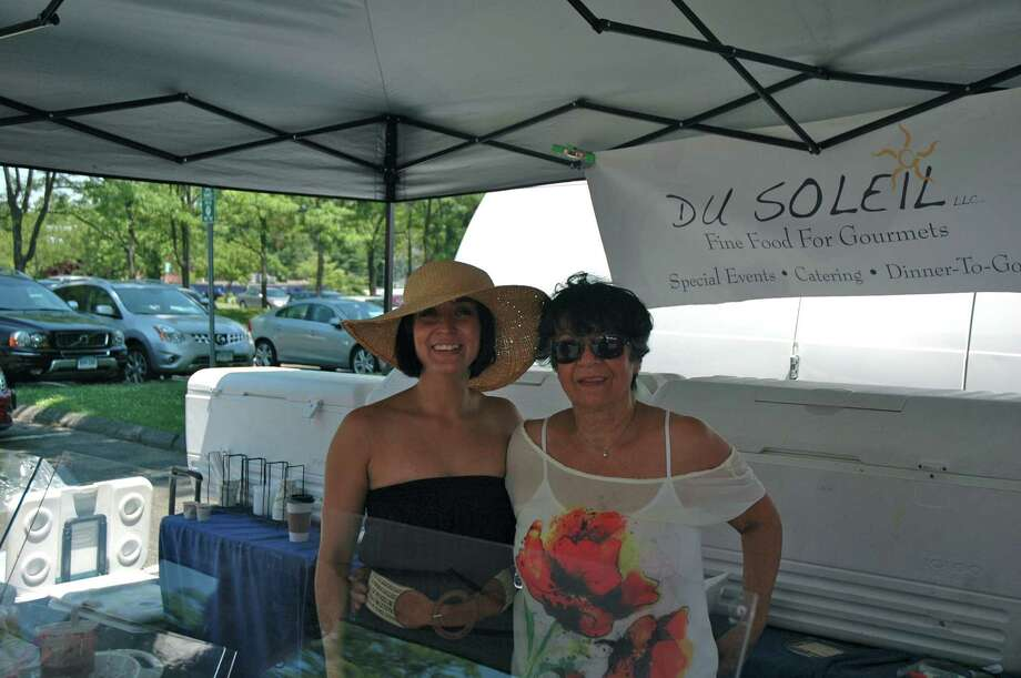 Maria Munoz Del Castillo and her mother, Soledad Del Castillo Blanco, of Du Soleil have been vendors at the New Canaan Farmers Market for two and a half years. Photo by Mac McDonough, June 30, 2012, New Canaan, Conn. Photo: Contributed Photo