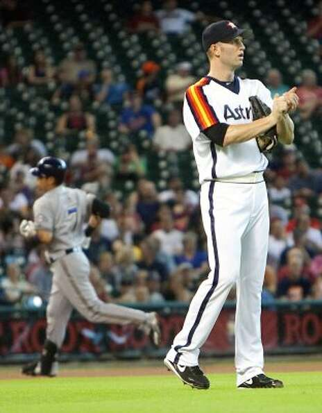July 6: Brewers 7, Astros 1 J.A. Happ, right, looks on after giving up a hom