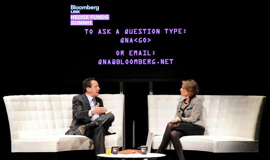 Dannel Malloy, governor of Connecticut, left, speaks with Susan Goldberg, executive editor at Bloomberg News, during the Bloomberg Hedge Funds Summit in New York, U.S., on Thursday Dec. 1, 2011. The conference covers the impact of the European debt crisis on the global markets, breaks down the fundamentals driving volatility in the equity markets, and looks at how investors can scratch beyond the veneer when investing in China. Photographer: Peter Foley/Bloomberg *** Local Caption *** Dannel Malloy; Susan Goldberg Photo: Peter Foley, Bloomberg / © 2011 Bloomberg Finance LP