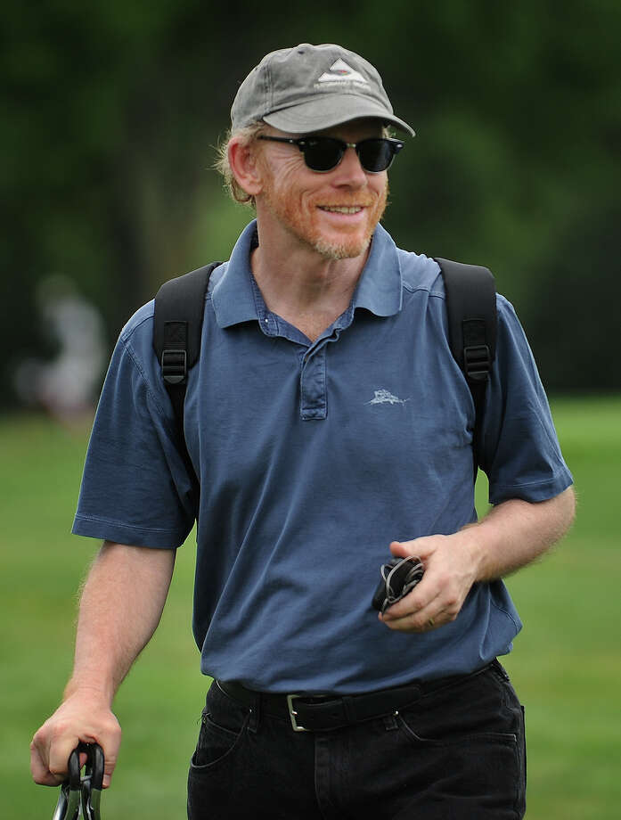 Actor-turned-movie director Ron Howard watches his son Reed Howard of Greenwich play in the Connecticut Open Golf Tournament at Brooklawn Country Club in Fairfield July 29, 2011. Photo: Brian A. Pounds, ST / Connecticut Post