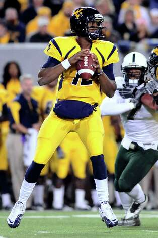QB Geno Smith and West Virginia poured it on at a rate of 37.6 points per game last season in the Big East. Can they keep it up in the Big 12? Photo: Jeff Gentner,  Associated Press