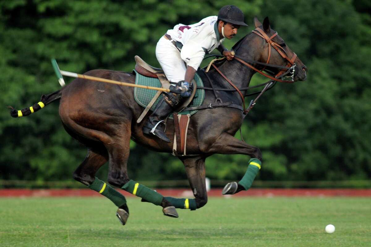 Buckleigh Farm polo team member aims for the ball on opening day of the Saratoga Polo Association 2012 season on Friday, July 6, 2012, in Greenfield Center, N.Y. (Cindy Schultz / Times Union)