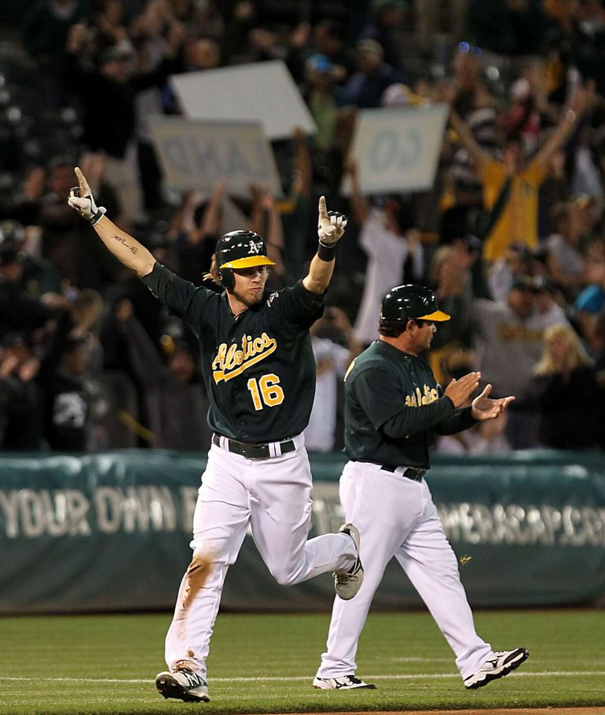 Oakland Athletics Josh Reddick scores off a Chris Carter three run home run in the bottom of the 11th inning to defeat the Seattle Mariners in their MLB baseball game 4-1 Friday, July 6, 2012, in Oakland California.