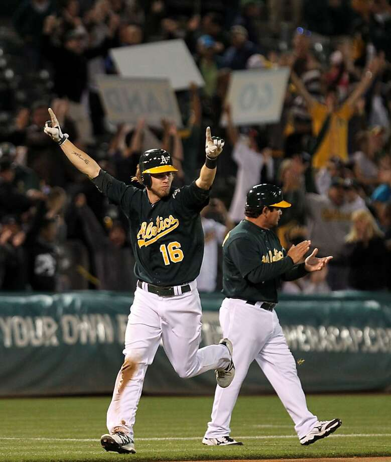 Oakland Athletics Josh Reddick scores off a Chris Carter three run home run in the bottom of the 11th inning to defeat the Seattle Mariners in their MLB baseball game 4-1 Friday, July 6, 2012, in Oakland California. Photo: Lance Iversen, The Chronicle