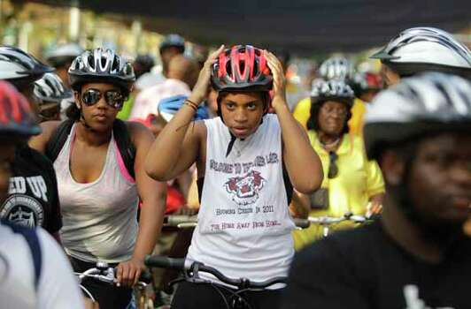Sierra Washington, a TSU student from San Antonio, adjusts her helmet as she and other riders prepare to start  the NAACP National Convention Bike Ride at Discovery Green on Saturday, July 7, 2012, in Houston.  Photo: Melissa Phillip, . / © 2012 Houston Chronicle