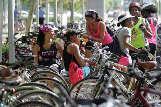 Participants rest after returning to Discovery Green at the end of Saturday's bike ride. Photo: Melissa Phillip, . / © 2012 Houston Chronicle