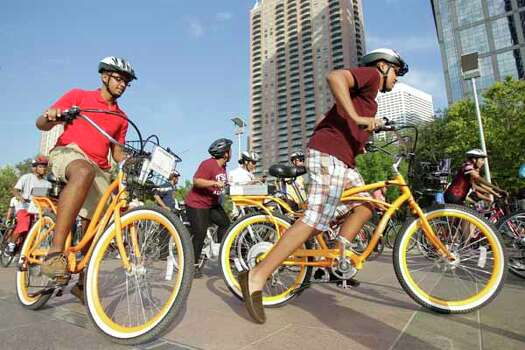 Michael Kebede, left, and Bronson Woods, right, both of Houston, begin the NAACP National Convention Bike Ride. Photo: Melissa Phillip, . / © 2012 Houston Chronicle