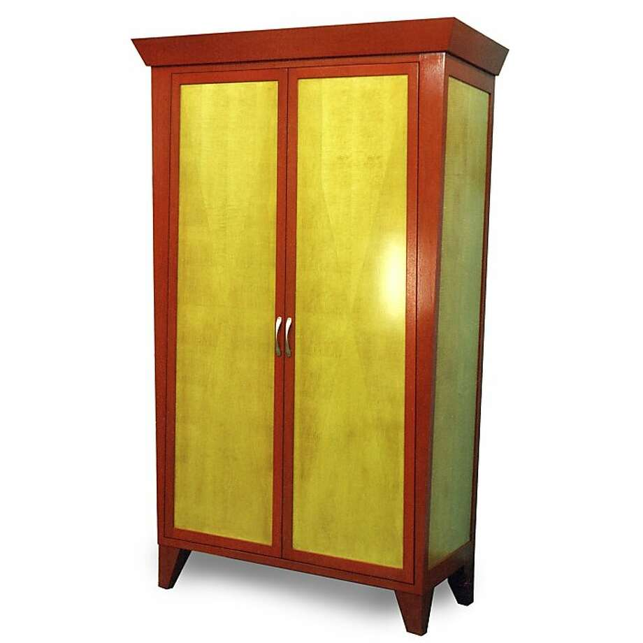 The Hall Clothes Armoire features stained curly maple and mahogany wood with a reverse box match veneer pattern on the doors. Photo: Courtesy Custom Furniture Design