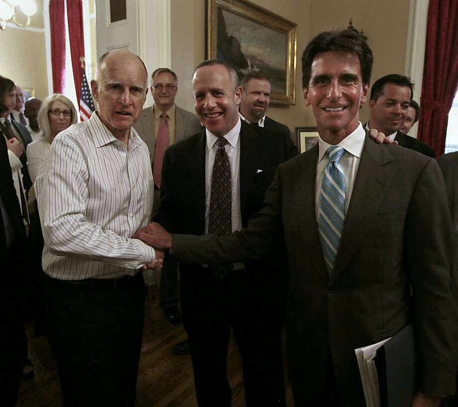 Gov. Jerry Brown, left, Senate President Pro Tem Darrell Steinberg, D-Sacramento, center, and Sen. Mark Leno, D-San Francisco, chair of the Senate Budget Committee smile for the camera after the Senate approved  funding for a high-speed rail system at the Capitol in Sacramento, Calif., Friday, July 6, 2012.   The bill, which would allow the state to begin selling $2.6 billion in voter-approved bonds, was approved by a 21-16 vote.(AP Photo/Rich Pedroncelli) Photo: Rich Pedroncelli, Associated Press