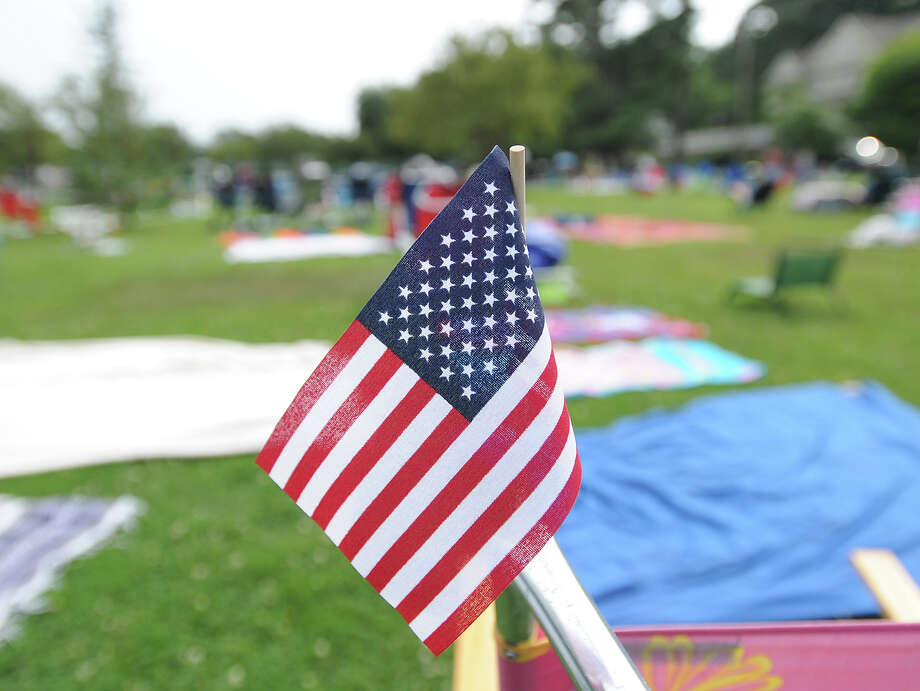 An American flag attached to a chair prior to the town fireworks display at Binney Park in Old Greenwich, Saturday, July 7, 2012. Photo: Bob Luckey / Greenwich Time