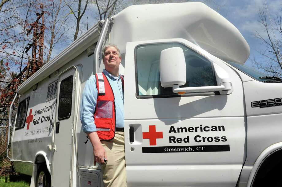 Greenwich resident Ross Ogden, the national chairman for disaster services for the American Red Cross, stands with their Disaster Services truck in April 2012. Photo: Helen Neafsey / Greenwich Time