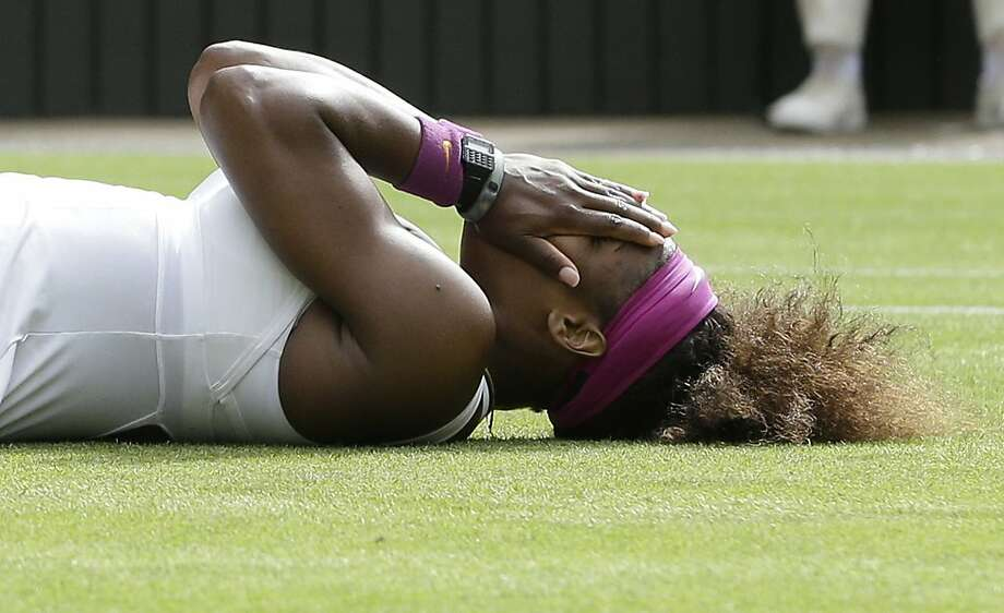 Serena Williams of the United States reacts after defeating Agnieszka Radwanska of Poland to win the women's final match at the All England Lawn Tennis Championships at Wimbledon, England, Saturday, July 7, 2012. (AP Photo/Kirsty Wigglesworth) Photo: Kirsty Wigglesworth, Associated Press