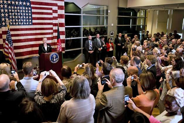 "US Secretary of State Hillary Rodham Clinton addresses staff at the US Embassy in Kabul Saturday July 7, 2012.  The Obama administration on Saturday declared Afghanistan the United States' newest ""major non-NATO ally,"" an action designed to facilitate close defense cooperation after U.S. combat troops withdraw from the country in 2014 and as a political statement of support for Afghanistan's long-term stability.  (AP Photo/Brendan Smialowski, Pool) Photo: Brendan Smialowski, Associated Press"