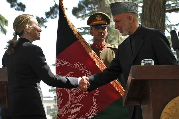 Afghan president Hamid Karzai (R) shakes hands with us Secretary of State Hillary Clinton (L) at the conclusion of a press conference at the Presidential Palace in Kabul on July 7, 2012. The United States has designated Afghanistan a major non-NATO ally, giving the war-torn country special privileges as the US prepares to pull its troops out in 2014, Secretary of State Hillary Clinton said July 7. AFP PHOTO / Massoud HOSSAINIMASSOUD HOSSAINI/AFP/GettyImages Photo: Massoud Hossaini, AFP/Getty Images