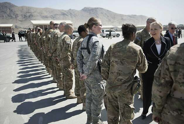 "US Secretary of State Hillary Rodham Clinton, right, greets troops before departing Kabul International Airport Saturday July 7, 2012. The Obama administration on Saturday declared Afghanistan the United States' newest ""major non-NATO ally,"" an action designed to facilitate close defense cooperation after U.S. combat troops withdraw from the country in 2014 and as a political statement of support for Afghanistan's long-term stability.    (AP Photo/Brendan Smialowski, Pool) Photo: Brendan Smialowski, Associated Press"
