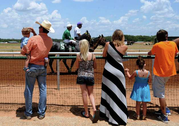 Race horses are paraded before the crowd at the Gillespie County Fairgrounds in Fredericksburg on Saturday, July 7, 2012. Photo: Billy Calzada, San Antonio Express-News / © 2012 San Antonio Express-News