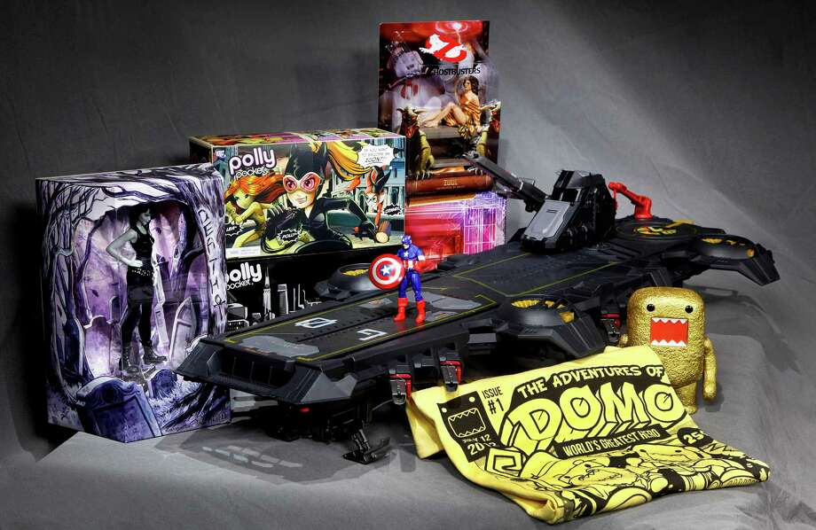 "In this July 5, 2012 photo, the Marvel Universe S.H.I.E.L.D. Super Helicarrier, at center with a Captain America figure on the foredeck, is seen with, from left background, a DC Comics Vertigo Death figurine, the Polly Pocket DC Comics Villain set, and a Dana as Zuul ""Ghostbusters"" figure, all special-issue Comic-Con 2012 collectibles, shown in Los Angeles. The annual four-day Comic-Con festival runs July 12-15, 2012, in San Diego. (AP Photo/Reed Saxon) Photo: Reed Saxon"