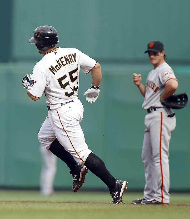 PITTSBURGH, PA - JULY 7:  Michael McKenry #55 of the Pittsburgh Pirates rounds second base on a solo home run in the fourth inning against the San Francisco Giants during the game on July 7, 2012 at PNC Park in Pittsburgh, Pennsylvania.  (Photo by Justin K. Aller/Getty Images) Photo: Justin K. Aller, Getty Images