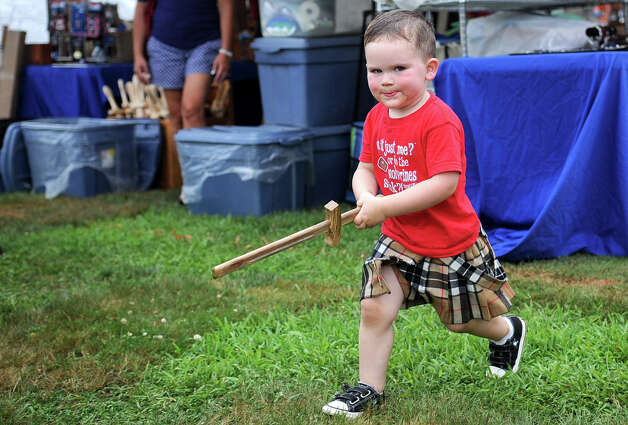 Donning a kilt and holding a wooden sword, Graeme Pirrie, 2, of Fairfield, runs around during the Round Hill Highland Games at Cranbury Park in Norwalk on Saturday, July 7, 2012. Photo: Lindsay Niegelberg / Stamford Advocate