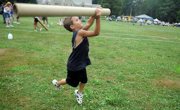 Christian Wallace, 5, participates in the children's Caber Toss during the Round Hill Highland Games at Cranbury Park in Norwalk on Saturday, July 7, 2012. Photo: Lindsay Niegelberg / Stamford Advocate