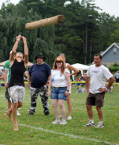 Logan Raymond, 12, participates in the children's Caber Toss during the Round Hill Highland Games at Cranbury Park in Norwalk on Saturday, July 7, 2012. Photo: Lindsay Niegelberg / Stamford Advocate