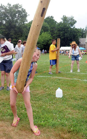 Alyssa MacRae, 10, participates in the children's Caber Toss during the Round Hill Highland Games at Cranbury Park in Norwalk on Saturday, July 7, 2012. Photo: Lindsay Niegelberg / Stamford Advocate