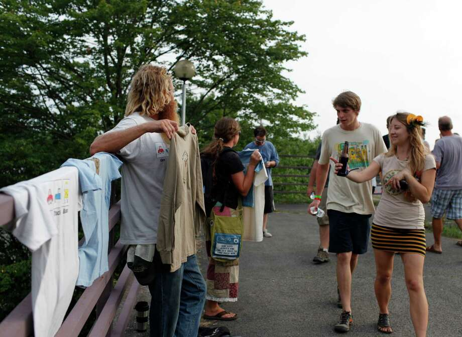 Jeff Siwicke, of Fort Myers Florida, sells t-shirts before the Phish concert outside of the Saratoga Performing Arts Center Friday, July 6, 2012 in Saratoga Springs, N.Y. (Dan Little/Special to the Times Union) Photo: Dan Little / Copyright: All Rights Reserved Brett Carlsen
