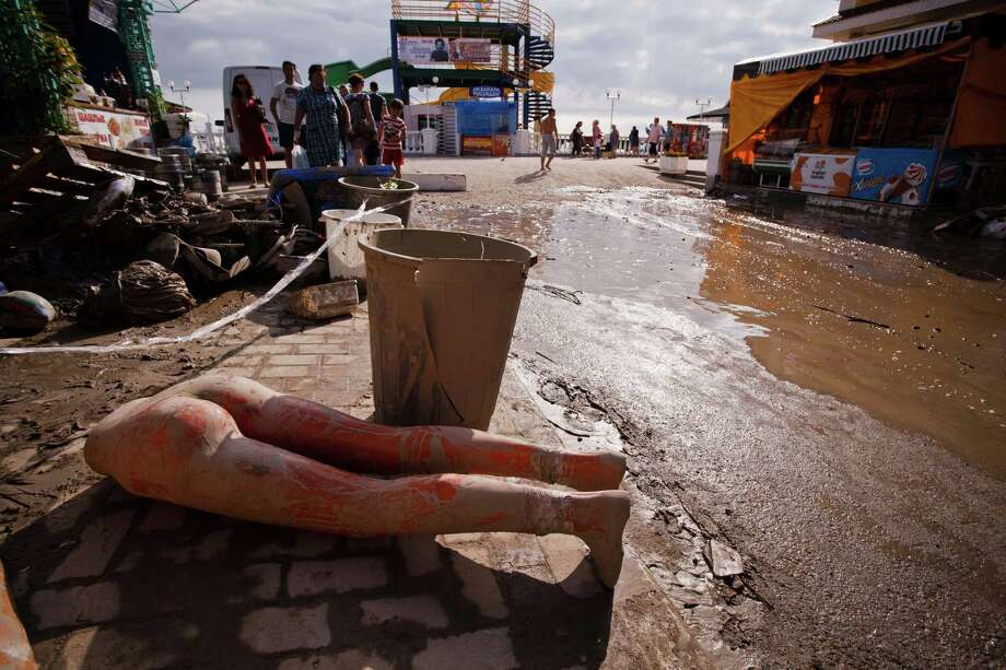 A part of destroyed mannequin by the flood is seen in mud in the Black Sea resort of Gelendzhik, southern Russia, Saturday, July 7, 2012. Photo: Ignat Kozlov, Associated Press / AP
