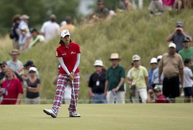 South Korea's Na Yeon Choi reacts after sinking a putt for birdie on the eighth green during the third round of the U.S. Women's Open golf tournament on Saturday, July 7, 2012, in Kohler, Wis. (AP Photo/Julie Jacobson) Photo: Julie Jacobson, Associated Press