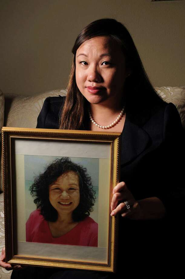 Yen-Chi Le holds a photo of her late mother, Catherine Tuong So Lam, who died in a 2008 bus crash north of Dallas. Photo: Dave Rossman / © 2012 Dave Rossman