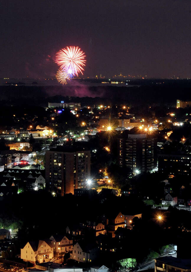 Fireworks in Greenwich are viewed from the rooftop of Trump Parc in Stamford on Saturday, July 7, 2012. Photo: Lindsay Niegelberg / Stamford Advocate