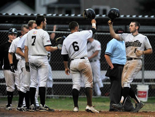 Danbury's Jake Gronsky, right, celebrates with his teammates after hitting a grand slam during the Westerners' game against the Vermont Mountaineers on Saturday, July 7, 2012. Danbury won, 12-9. Photo: Jason Rearick / The News-Times