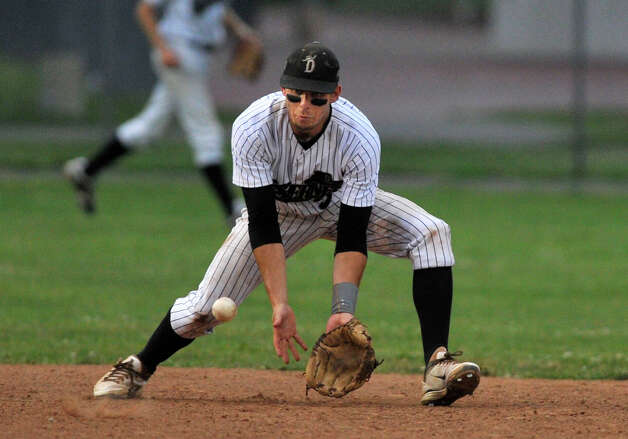 Danbury shortstop Zach Shank gets in front of the ball during the Westerners' game against the Vermont Mountaineers on Saturday, July 7, 2012. Danbury won, 12-9. Photo: Jason Rearick / The News-Times