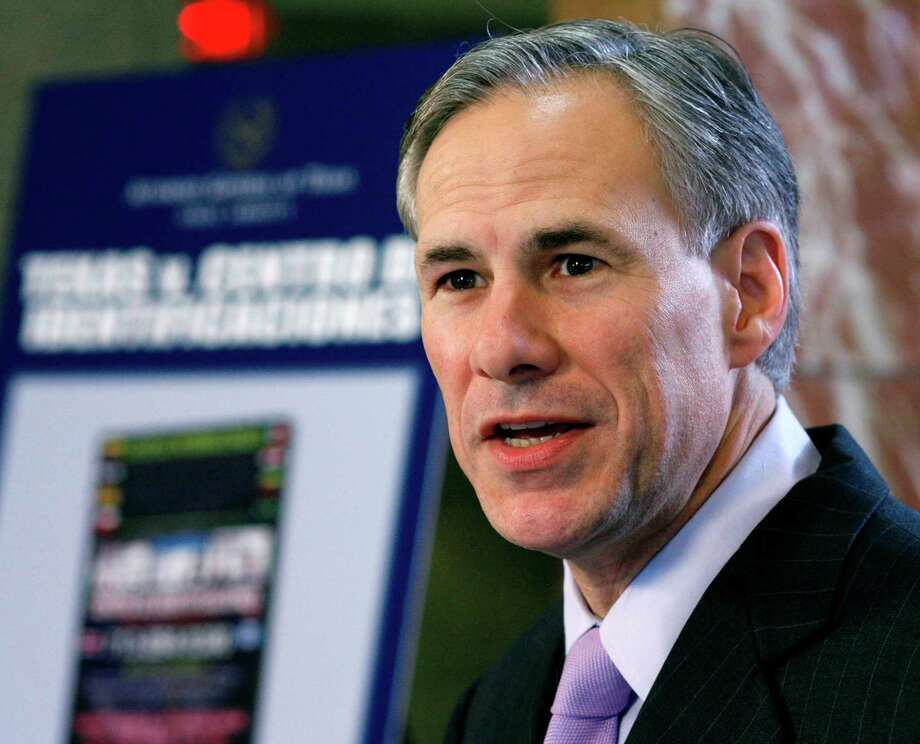 Paid for with Texas Attorney General Greg  Abbott's campaign funds, the ads reference the nation's toughest gun  control law. Photo: Harry Cabluck / AP