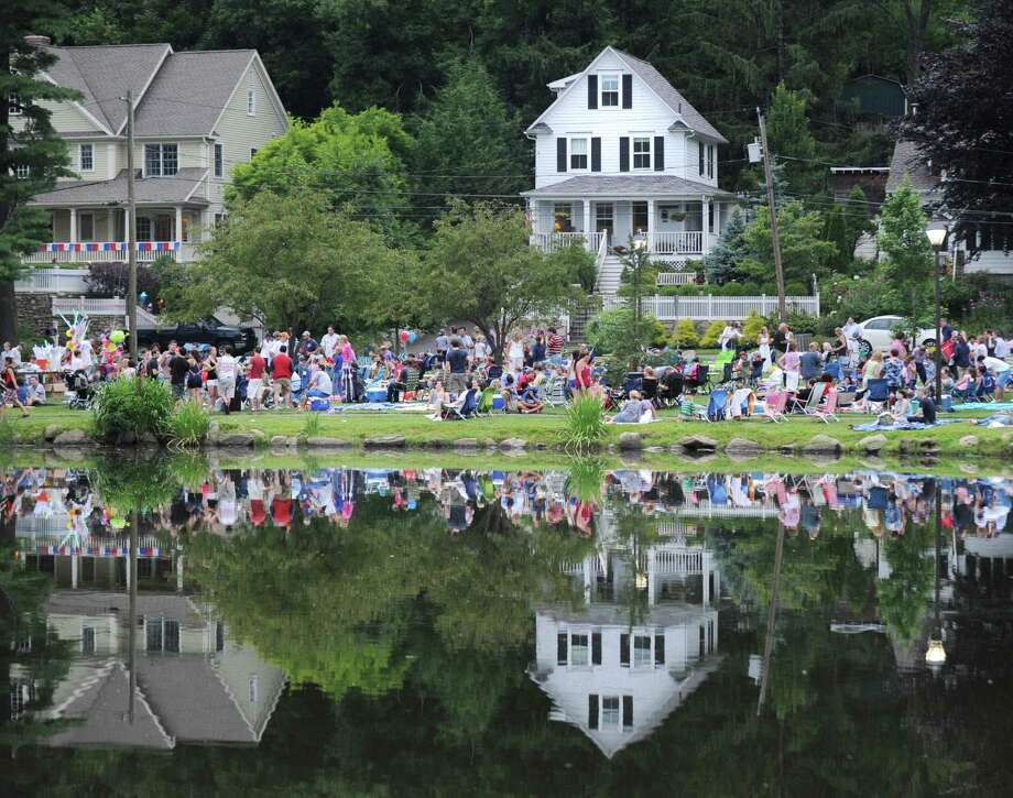 The crowd reflected in Binney Park Pond prior to the town fireworks display in Old Greenwich, Saturday night, July 7, 2012. Photo: Bob Luckey / Greenwich Time