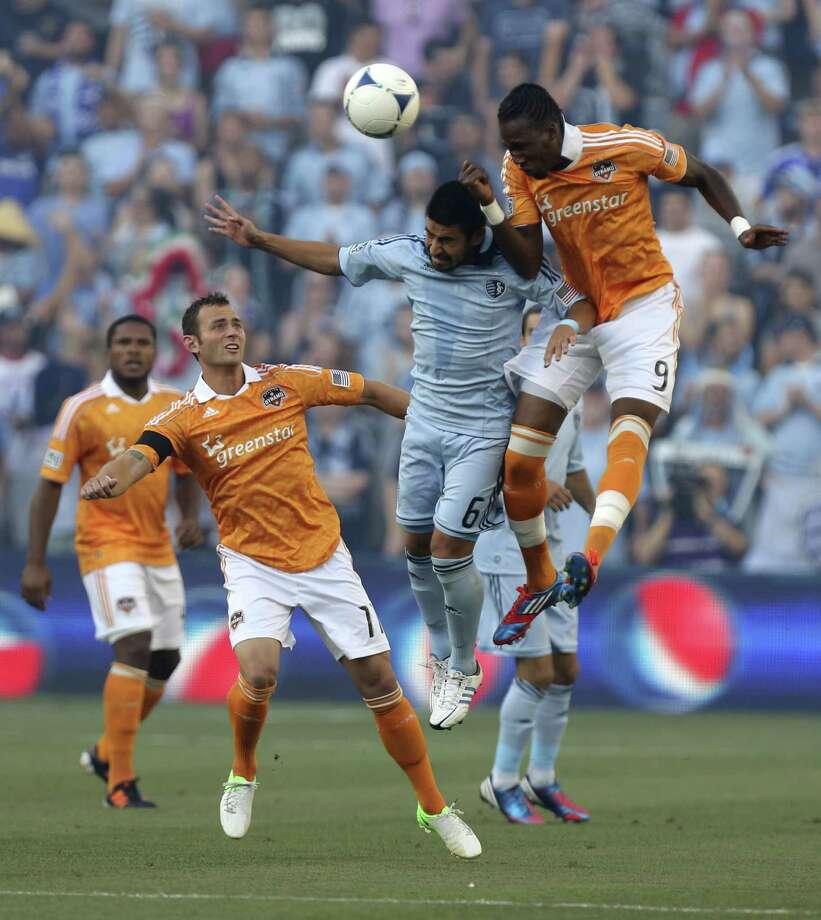 Macoumba Kandji heads the ball away from Paulo Nagamura. Photo: Ed Zurga, Getty Images / 2012 Getty Images