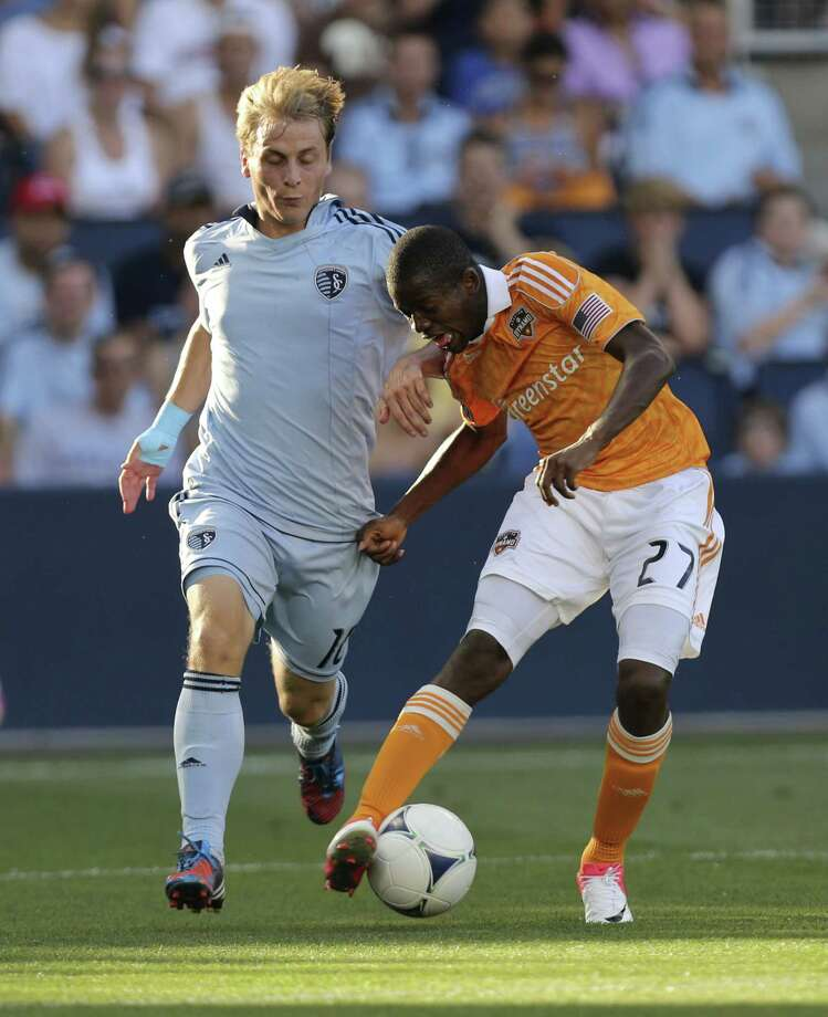 Boniek Garcia and Seth Sinovic vie for the ball in the first half. Photo: Ed Zurga, Getty Images / 2012 Getty Images