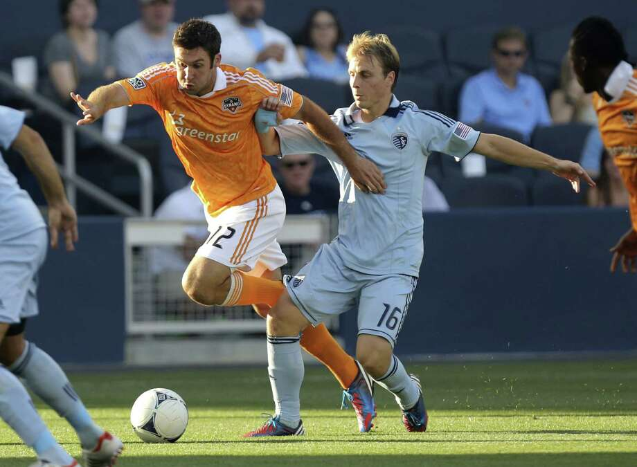Will Bruin and Seth Sinovic vie for the ball in the first half. Photo: Ed Zurga, Getty Images / 2012 Getty Images