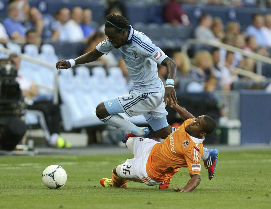 Kei Kamara is tripped up by Corey Ashe as they vie for the ball in the second half. at Livestrong Sporting Park on July 7, 2012 in Kansas City, Kansas. The game ended in a 0-0 tie. Photo: Ed Zurga, Getty Images / 2012 Getty Images