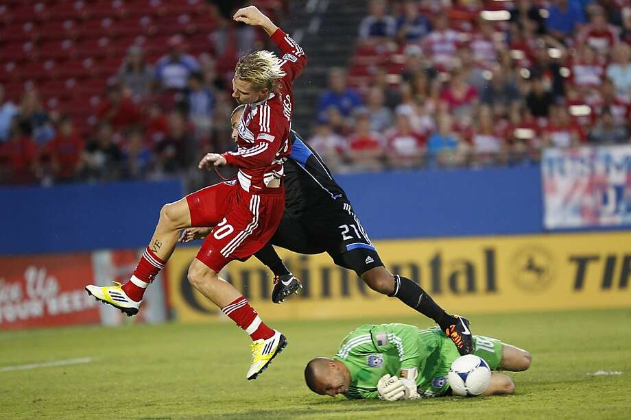 FRISCO, TX - JULY 7: Jason Hernandez #21 and Jon Busch #18 of San Jose Earthquakes defend and block a shot by Brek Shea #20 of FC Dallas at FC Dallas Stadium on July 7, 2012 in Frisco, Texas. (Photo by Rick Yeatts/Getty Images) Photo: Rick Yeatts, Getty Images