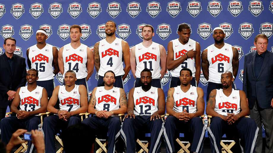 Coach Mike Krzyzewski (back left) and chairman Jerry Colangelo (back right) pose with the 2012 USA basketball team for the London Olympics. Photo: Jason Bean, Associated Press