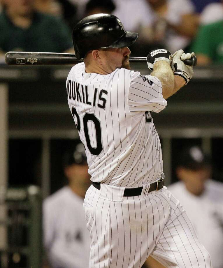 Chicago White Sox's Kevin Youkilis follows through on an RBI single against the Toronto Blue Jays during the fifth inning of a baseball game in Chicago, Friday, July 6, 2012. (AP Photo/Sitthixay Ditthavong) Photo: Sitthixay Ditthavong